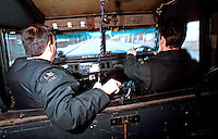 R.U.C. officers on patrol in their armoured personnel landrover in Northern Ireland. This image may only be used to portray the subject in a positive manner..©shoutpictures.com..john@shoutpictures.com