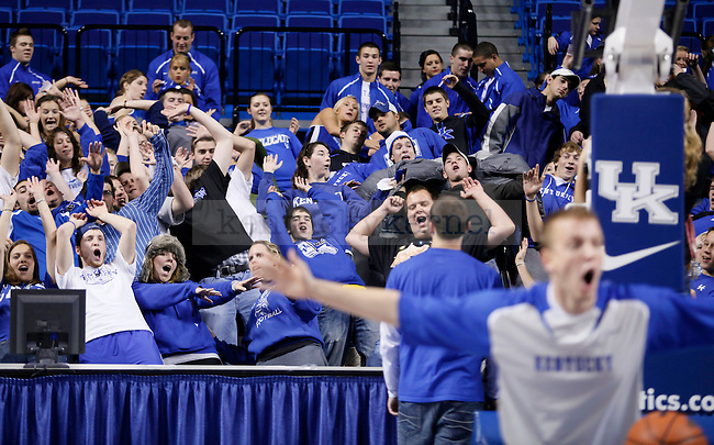 Kentucky fans topple over after Wildcat Ross Turner dunks during the cheer practice at Rupp Arena on Wenesday evening. Photo by Zach Brake | Staff