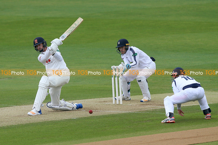 Matt Quinn hits out for Essex as Lewis McManus looks on from behind the stumps during Essex CCC vs Hampshire CCC, Specsavers County Championship Division 1 Cricket at The Cloudfm County Ground on 20th May 2017