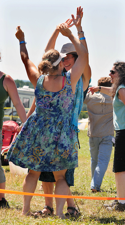 "Members of the audience dancing to the music during the  ""Gospel Wake Up Call"" Show at the Main Stage at the Falcon Ridge Folk Festival, held on Dodd's Farm in Hillsdale, NY on Sunday, August 2, 2015. Photo by Jim Peppler. Copyright Jim Peppler 2015."