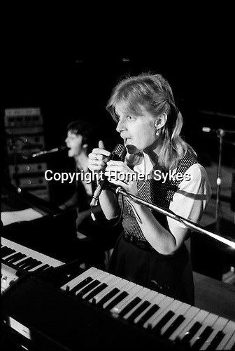 "Paul and Linda McCartney Wings Tour 1975. Linda during a rehearsal in the Elstree rehearsal studio. London. England.. The photographs from this set were taken in 1975. I was on tour with them for a children's ""Fact Book"". This book was called, The Facts about a Pop Group Featuring Wings. Introduced by Paul McCartney, published by G.Whizzard. They had recently recorded albums, Wildlife, Red Rose Speedway, Band on the Run and Venus and Mars. I believe it was the English leg of Wings Over the World tour. But as I recall they were promoting,  Band on the Run and Venus and Mars in particular."