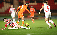 Blackpool's Nathan Delfouneso and Doncaster Rovers' Ben Whiteman<br /> <br /> Photographer Rachel Holborn/CameraSport<br /> <br /> The EFL Sky Bet League One - Doncaster Rovers v Blackpool - Tuesday 27th November 2018 - Keepmoat Stadium - Doncaster<br /> <br /> World Copyright &copy; 2018 CameraSport. All rights reserved. 43 Linden Ave. Countesthorpe. Leicester. England. LE8 5PG - Tel: +44 (0) 116 277 4147 - admin@camerasport.com - www.camerasport.com