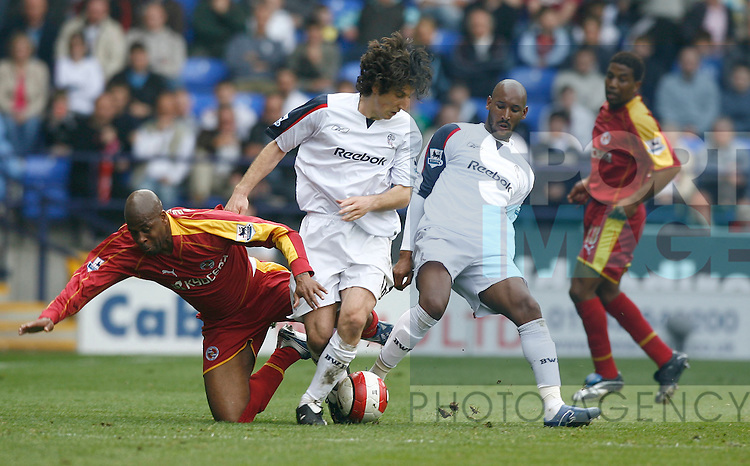 Bolton Wanderer's Andranik and Nicolas Anelka tackle Reading's Michael Duberry