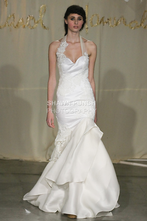 Model walks runway in a Satin Leaf wedding dress by Carol Hannah Whitfield, for the Carol Hannah Spring Summer 2012 Bridal collection runway show.