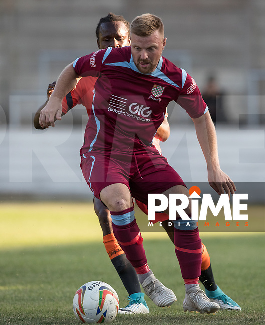 Jon Jo Bates of Chesham United holds off Marcus Bean of Wycombe Wanderers during the 2018/19 Pre Season Friendly match between Chesham United and Wycombe Wanderers at the Meadow , Chesham, England on 24 July 2018. Photo by Andy Rowland.
