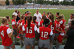 24 August 2014: OSU head coach Lori Walker talks to her team. The University of North Carolina Tar Heels hosted the Ohio State University Buckeyes at Fetzer Field in Chapel Hill, NC in a 2014 NCAA Division I Women's Soccer match. UNC won the game 1-0.