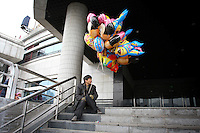 CHINA. Sichuan Province. Chongqing. A migrant worker selling balloons near The Yangtze River which is at its lowest level in 150 years as a result of a country-wide drought. Chongqing is a city of over 3,000,000 people, famed for being the capital of China between 1938 and 1946 during World War II. It is situated on the banks of the Yangtze river, China's longest river and the third longest in the world. Originating in Tibet, the river flows for 3,964 miles (6,380km) through central China into the East China Sea at Shanghai.  2008.