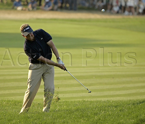 18 June 2006: Scottish golfer Colin Montgomerie (Sco) hacks out of the rough on the 18th during the final round of the 2006 U.S. Open Championship held at Winged Foot Golf Club in Mamaroneck, New York. Montgomerie finished joint second on +4, one behind G Ogilvy. Photo: Rich Kane/actionplus...golf man player major 060618