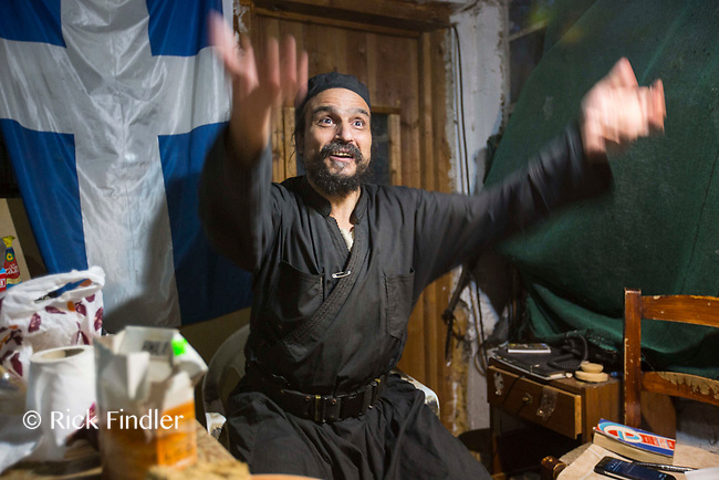 Mount Athos - The Holy Mountain.<br /> Father Iusif tells a story inside his kitchen.<br /> <br /> Photographer: Rick Findler