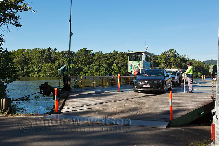 Cars disembarking the Daintree River cable ferry.  Daintree National Park, Queensland, Australia