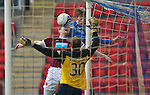 St Johnstone v Hearts....24.03.12   SPL.Andy Webster blocks Murray Davidson.Picture by Graeme Hart..Copyright Perthshire Picture Agency.Tel: 01738 623350  Mobile: 07990 594431