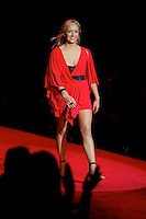 2/13/09 - Photo by John Cheng.  Nastia Liukin walks down the runway at the Red Dress Collection Fashion Show in Bryant Park, New York.  February is National Heart Month, and the fashion show is part of the month-long activities to raise women?s heart disease awareness.