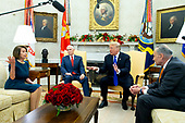 US President Donald J. Trump (C) and US Vice President Mike Pence (2-L) meet with US House Speaker-designate Nancy Pelosi (L) and US Senate Minority Leader Chuck Schumer (R), in the Oval Office of the White House in Washington, DC, USA, 11 December 2018. Trump, Pelosi and Schumer had a disagreement on border policy and shutting down the government.<br /> Credit: Michael Reynolds / Pool via CNP