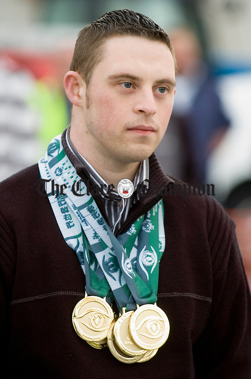 Special Olympics champion William Loughnane wearing his six Gold and one bronze medals during his homecoming celebration at Spancill hill. Photograph by John Kelly.