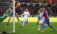 Gylfi Sigurdsson of Swansea (C) looks on as his shot goes past Wayne Hennessey of Crystal Palace (L) who dies during the Barclays Premier League match between Swansea City and Crystal Palace at the Liberty Stadium, Swansea on February 06 2016