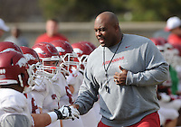 NWA Media/ANDY SHUPE - Arkansas assistant coach Clay Jennings speaks to players during practice Saturday, Dec. 13, 2014, at the university's practice facility in Fayetteville.