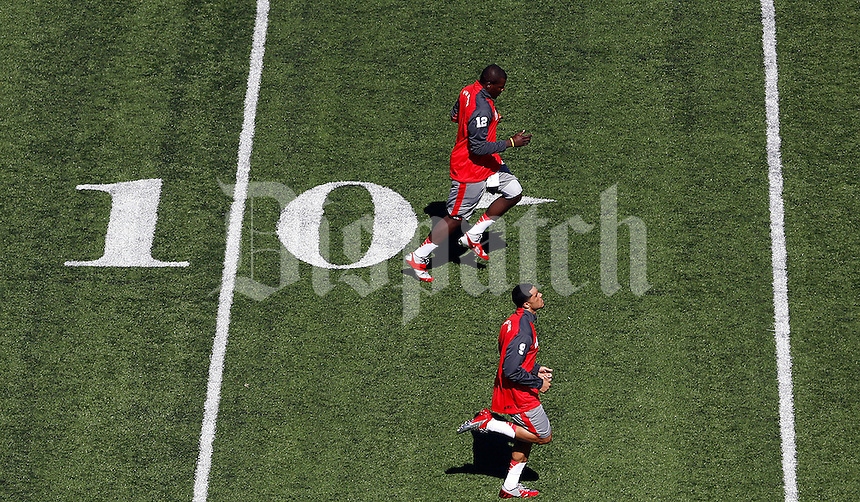 Ohio State Buckeyes wide receiver Devin Smith (9)(bottom) and Ohio State Buckeyes quarterback Cardale Jones (12)(top) warm up before their game against California Golden Bears at Memorial Stadium in Berkeley, California on September 14, 2013.  (Dispatch photo by Kyle Robertson)