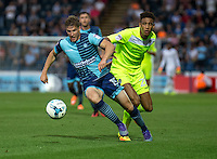 Dayle Southwell of Wycombe Wanderers and Kurtis Guthrie of Colchester United during the Sky Bet League 2 match between Wycombe Wanderers and Colchester United at Adams Park, High Wycombe, England on 27 August 2016. Photo by Liam McAvoy.