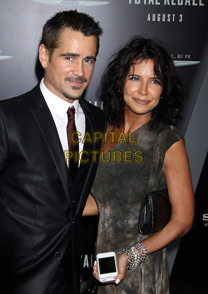"Colin Farrell, Claudine Farrell.""Total Recall"" Los Angeles Premiere held at Grauman's Chinese Theatre, Hollywood, California, USA..August 1st, 2012.half length suit grey gray dress brother siblings family silver bracelets black white tie purple goatee soul patch moustache mustache facial hair tie dye sister mobile phone .CAP/ADM/RE.©Russ Elliot/AdMedia/Capital Pictures."