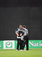 NZ's Brendon McCullum dries the ball for Jesse Ryder in the rain during the 2nd ODI cricket match between the New Zealand Black Caps and India at Westpac Stadium, Wellington, New Zealand on Friday, 6 March 2009. Photo: Dave Lintott / lintottphoto.co.nz
