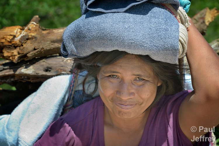 A Wichi indigenous woman carries firewood in Santa Victoria Este, a town in the Chaco region in northern Argentina. The Wichi, who traditionally survived as hunter-gatherers, have struggled against the systematic expropriation of their land for over a century by mestizo cattleraisers who migrated into the region from elsewhere in Argentina. In 2014, the two groups finally agreed on a division of the land which recognizes the traditional land rights of the indigenous, and which resettles many mestizo families onto non-indigenous land. Church World Service has worked as a partner with local residents as they negotiated the landmark settlement.