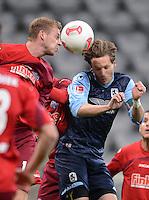 Fussball 2. Bundesliga:  Saison   2012/2013,    16. Spieltag  TSV 1860 Muenchen - SC Paderborn  27.11.2012 Thomas Bertels (li, SC Paderborn 07) gegen Benjamin Lauth (1860 Muenchen)