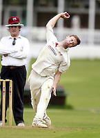 Jack Peck bowls for Highgate during the Middlesex County Cricket League Division Three game between Highgate and South Hampstead at Park Road, Crouch End on Sat Aug 2, 2014
