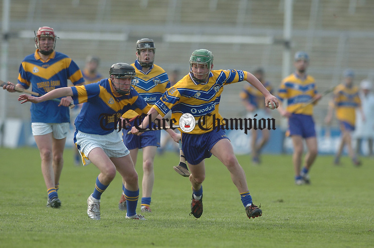 Sean Collins of East Clare evades his north tTipperary opponent during their U-16 divisional championship game in Limerick. Photograph by John Kelly.