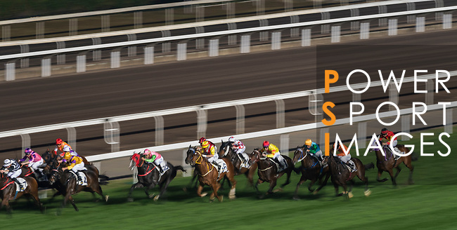 Jockey Leandro Henrique Espindola de Oliveira riding Happilababy #10 and jockey Neil Callan riding Keen Venture #6 compete in the Race 10, Maurice Handicap, during the Longines Hong Kong International Races at Sha Tin Racecourse on December 10 2017, in Hong Kong, Hong Kong. Photo by Victor Fraile / Power Sport Images