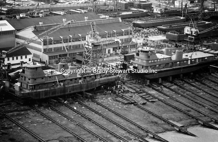 Pittsburgh PA: View of the Dravo shipyard on Neville Island that built tugs and towboats - 1964.  The shipyard started operation in 1919 and closed in 1983. <br /> The new boat was called the Steel Express built for the Ohio Barge Lines.  The other boat was named the Harllee Branch being built for Midland Express.