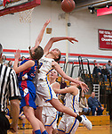 WINSTED,  CT-021919JS15- Housatonic's Sydney Segalla  (13) blocks a shot of Nonnewaug's Maddie Woodward (34)  during their Berkshire League semi-final game Tuesday at Northwestern Regional High School in Winsted. <br /> Jim Shannon Republican American