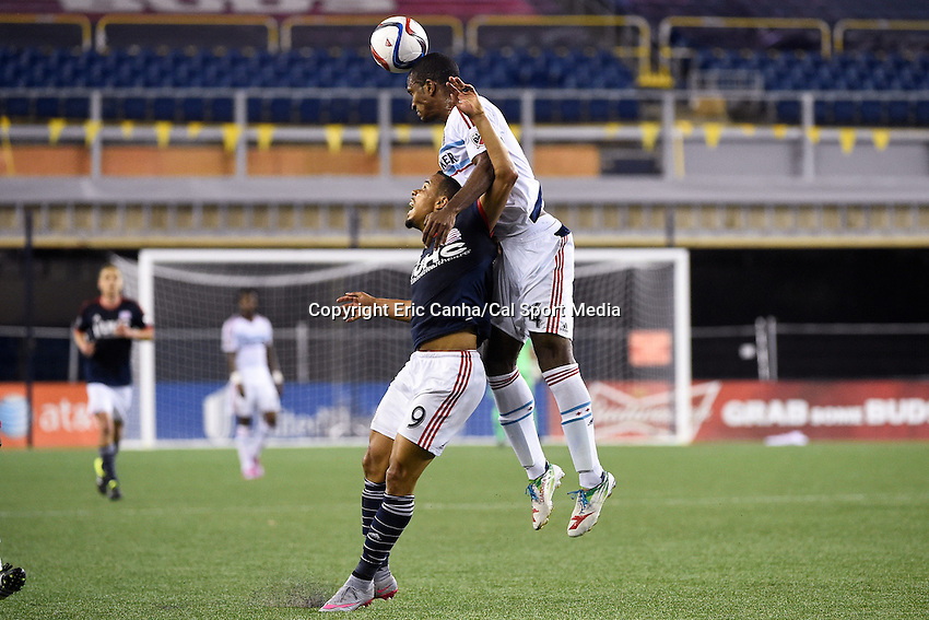 June 13, 2015 - Foxborough, Massachusetts, U.S. -Chicago Fire defender Adailton (4) leaps over New England Revolution forward Charlie Davies (9) to head the ball during the MLS game between Chicago Fire and the New England Revolution held at Gillette Stadium in Foxborough Massachusetts. The Revolution defeated the Fire 2-0. Eric Canha/CSM