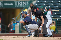 Bowling Green Hot Rods catcher Chris Betts (26) sets a target as home plate umpire A.J. Choc looks on during the game against the Fort Wayne TinCaps at Parkview Field on August 20, 2019 in Fort Wayne, Indiana. The Hot Rods defeated the TinCaps 6-5. (Brian Westerholt/Four Seam Images)