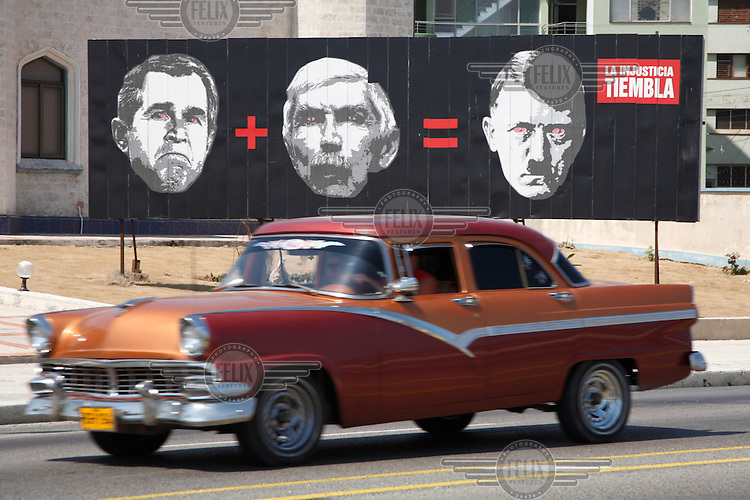 A billboard which says George Bush + Luis Posada Carriles = Adolf Hitler. Carriles is an anti-Castro Cuban and former CIA operative living in exile in the US.