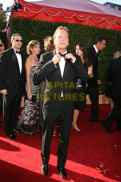 KIEFER SUTHERLAND.59th Annual Primetime Emmy Awards held at the Shrine Auditorium, Los Angeles, California, USA,.16 September 2007..full length adjusting touching bow tie keifer black suit.CAP/ADM/RE.©Russ Elliot/AdMedia/Capital Pictures.