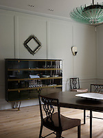 In the dining room the Scottish mahogany chairs date from 1870 and the lacquered cabinet is by Maison Leleu