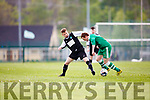 Gary Rogers Killarney Celtic gets his tackle in against Boyle Celtic during their FAI cup clash in Killarney on Saturday
