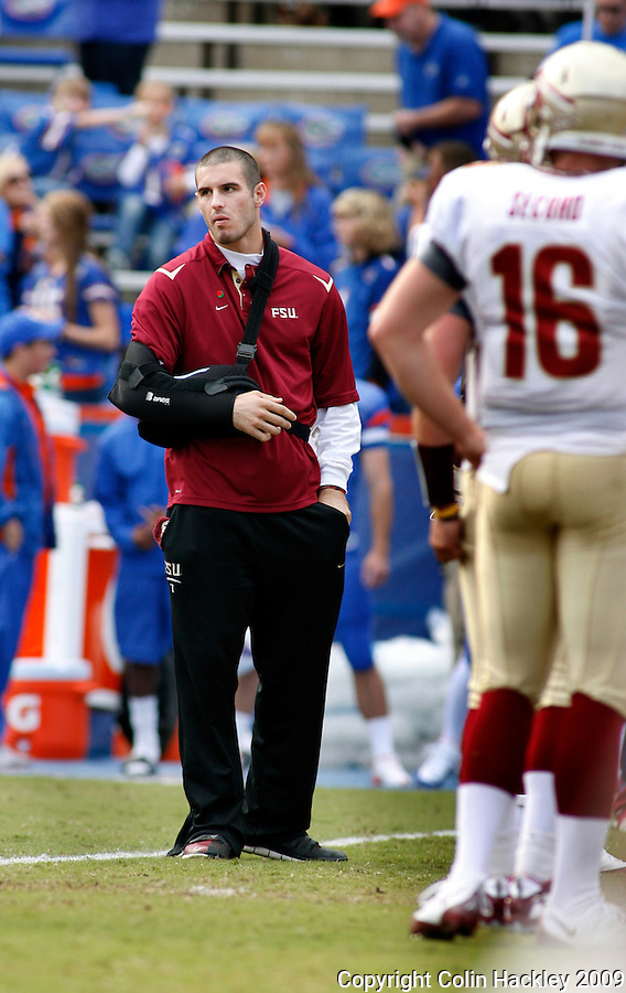 GAINESVILLE, FL 11/28/09-FSU-UF FB09 CH73-Florida State quarterback Christian Ponder watches the Seminoles warm up prior to the Florida game Saturday at Florida Field in Gainesville. Ponder underwent shoulder surgery recently and is expected to be ready for the 2010 season..COLIN HACKLEY PHOTO