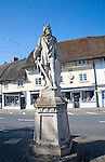 King Alfred the Great statue in the market place and thatched shop buildings village of Pewsey, Wiltshire, England