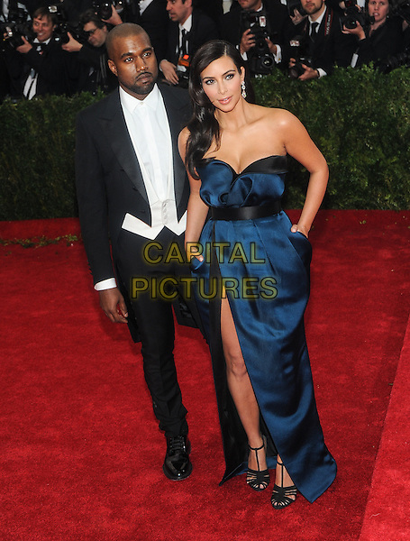 NEW YORK, NY - MAY 5: Kanye West and Kim Kardashian arrives at the Costume Institute Benefit at The Metropolitan Museum of Art on May 5, 2014 in New York. Photo Credit: RTNStevens/MediaPunch<br /> CAP/MPI/RTNSTV<br /> &copy;RTNSTV/MPI/Capital Pictures