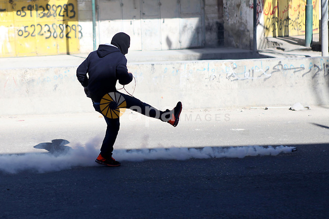 A Palestinian protester kicks back a tear gas canister fired by Israeli security forces during clashes following an anti-Israel protest against the recent visits by Jewish activists to al-Aqsa mosque, at Qalandia checkpoint near the West Bank city of Ramallah November 7, 2014. In recent weeks there have been near-daily clashes between the stone-throwing Palestinians and Israeli riot police in occupied East Jerusalem. Some of the attacks have turned deadly. The unrest was triggered by Muslim fears of Jewish encroachment at the sacred site, a hilltop plateau known to Muslims as Haram as-Sharif, or Noble Sanctuary, and to Jews as the Temple Mount. Photo by Shadi Hatem