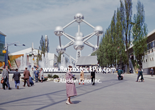 Brussels Worlds Fair 1958. People walking by fountain with Atomium in the background