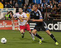 March 10th, 2013: Adam Jahn controls the ball away from Heath Pearce during a game at Buck Shaw Stadium, Santa Clara, Ca.   Earthquakes defeated Red Bulls 2-1