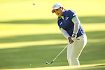 Inbee Park chips her ball onto the 14th green at the LPGA Championship 2014 Sponsored By Wegmans at Monroe Golf Club in Pittsford, New York on August 17, 2014