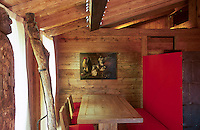 Two large wooden sculptures dominate the small dining area