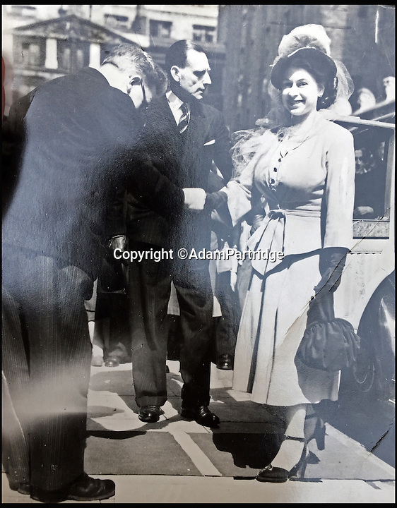 BNPS.co.uk (01202 558833)<br /> Pic: AdamPartridge/BNPS<br /> <br /> Alexander Usher pictured to the left of the Queen.<br /> <br /> A fascinating photo archive that documents the dedication of one of the Queen's bodyguards has come to light 70 years later.<br /> <br /> Police Inspector Alexander Usher was appointed 'No.1 Shadow' to Princess Elizabeth in 1944, when she was aged 18 and 'heir presumptive' to the throne behind her father King George VI.<br /> <br /> Mr Usher served alongside her until 1951, by which time she had married Prince Philip. He even went on their honeymoon.<br /> <br /> The album of photo which he features in is now being sold by Adam Partridge auctioneers.