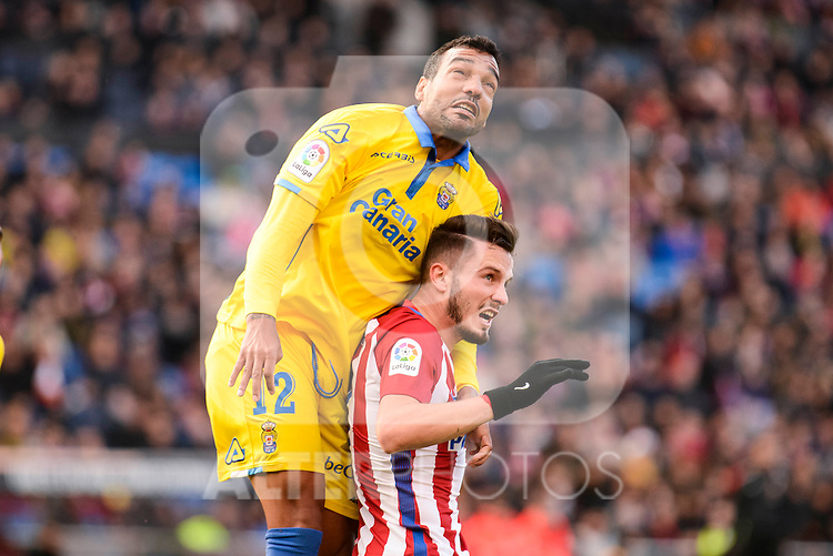 Atletico de Madrid Saul Ñiguez and UD Las Palmas Michel Macedo during La Liga match between Atletico de Madrid and UD Las Palmas at Vicente Calderon Stadium in Madrid, Spain. December 17, 2016. (ALTERPHOTOS/BorjaB.Hojas)