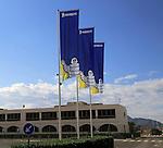 Company flags with logo Bibendum figure flying outside, Michelin factory and research establishment, Almeria, Spain
