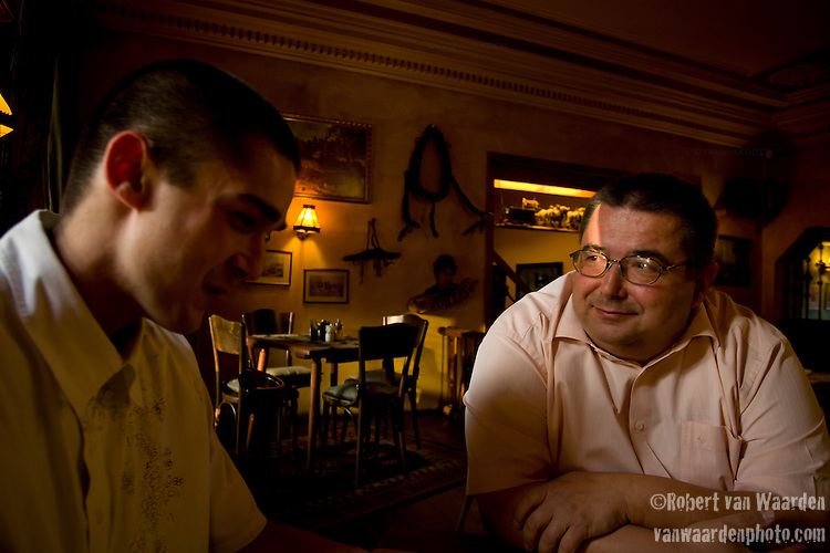 David Jozefy, talks with his son, Adam over dinner in Karlovy Vary,  Czech Republic. A true guru of the Czech wind energy industry, David Jozefy has been involved in the industry for the last 20 years. He probably knows the story behind every windmill in the country. He is a consultant, owner and developer of wind energy and is currently working on several projects all that were approved before the clean energy freeze currently underway in the Czech Republic. He believes that to change the energy system it needs to come from a government level and that the Czech national plans have to coincide with the promises being made at an EU level.