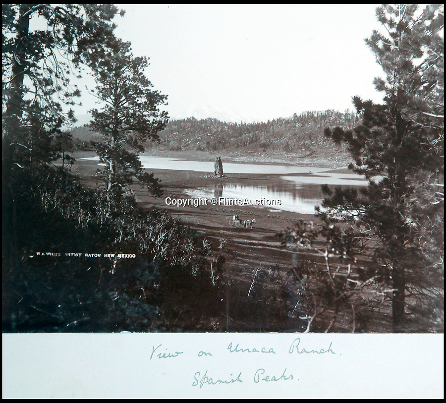 BNPS.co.uk (01202 558833)<br /> Pic: FlintsAuctions/BNPS<br /> <br /> View of the Urraca Ranch in New Mexico with the Spanish Peaks beyond.<br /> <br /> Unseen album reveals the life of a cowboy in the real wild west...<br /> <br /> Fascinating previously unseen early photos of cowboys in the Wild West have come to light 130 years later.<br /> <br /> They show life on the ranches of Colorado and New Mexico in the vast expanses of the south west US in the 1880s.<br /> <br /> One dramatic image captures the thrilling moment a group of cowboys ride towards the camera with hats held aloft.<br /> <br /> The photos are thought to have been taken by a British farmhand who travelled Stateside in the late 19th century to earn a living.